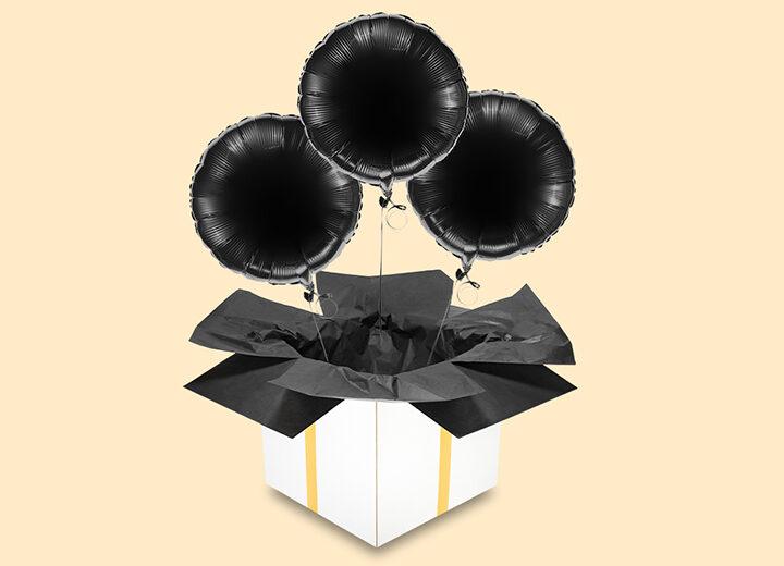 Trzy czarne balony koła